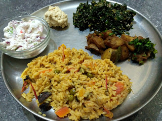Tomato Veg rice, Ponnaanganni greens poriyal, Steamed Potato masala, Coconut chutney, Coconut Curd Onion Raitha