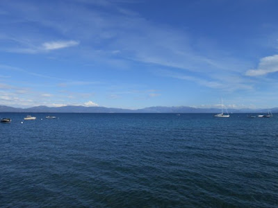spiritual freedom, spiritual presence, lake, blue sky, boats, spiritual awakening