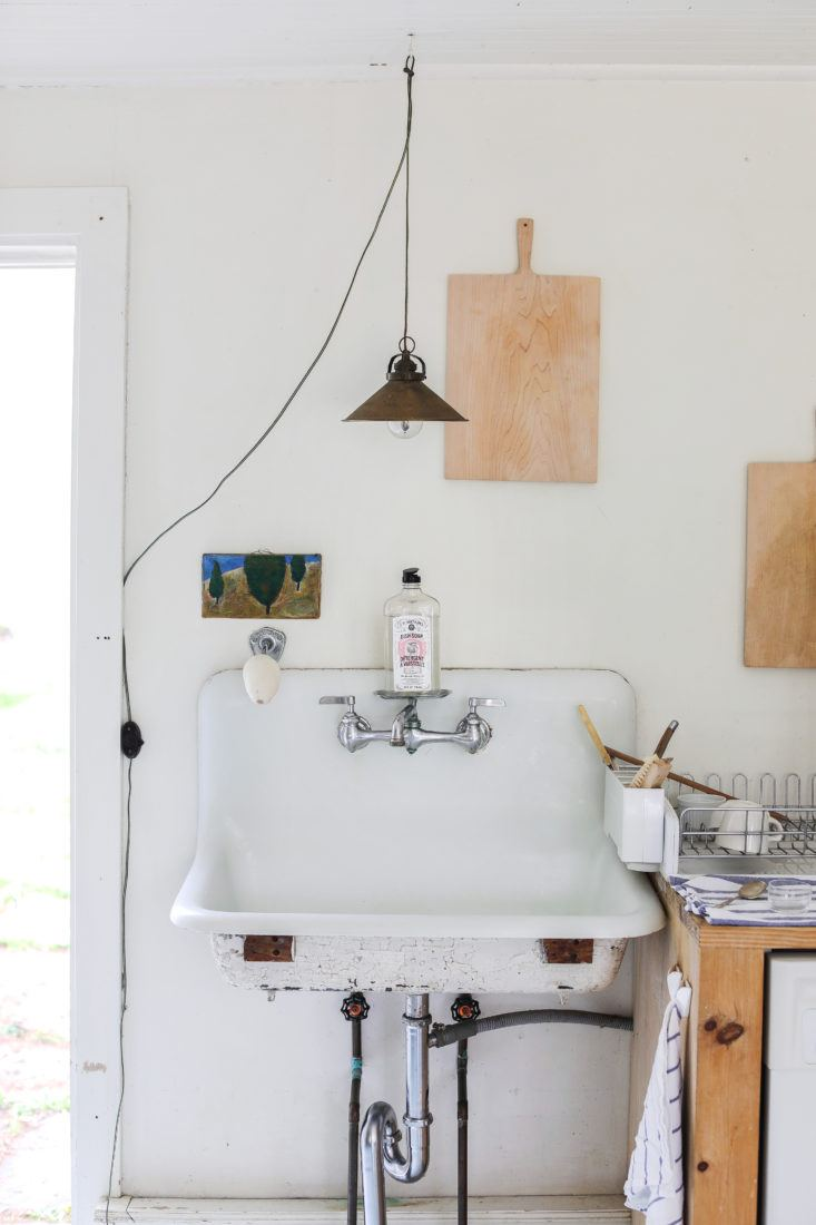 Minimal and soulful farmhouse style interior with country sink and slow living vibe - found on Hello Lovely Studio