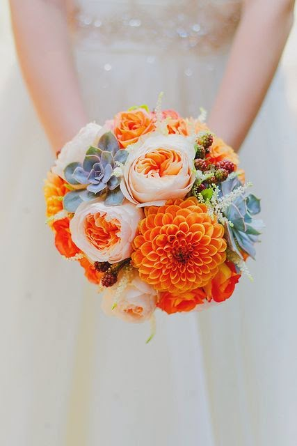 bouquet of succulents and orange dahlias