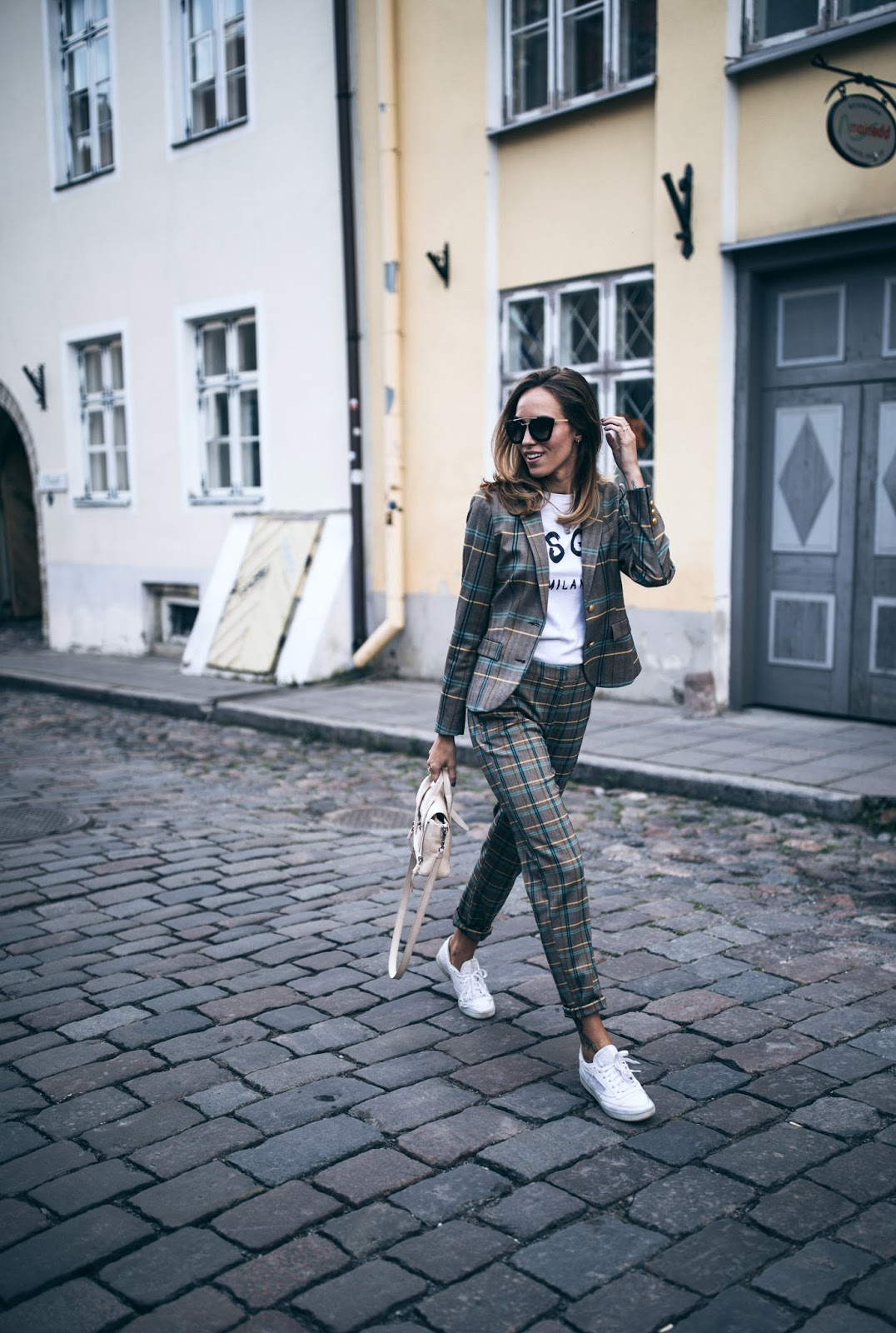 checked suit sneakers tshirt street style