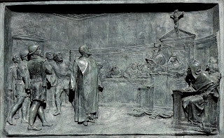 A relief of the trial of Bruno by the Roman Inquisition forms part of Ettore Ferrari's moment in Rome