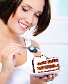 Girl eating gateau with spoon