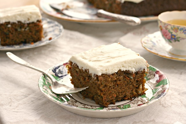"Wholesome carrot cake recipe is lower in fat than many carrot cake recipes and has less sugar too. It includes whole grain flour and a whopping three cups of grated carrots. I give it a light skim of cream cheese frosting on the top only so you get a bit of creamy sweet flavour in each bite. The recipe is made in a 9"" x 13"" pan so feeds a crowd."
