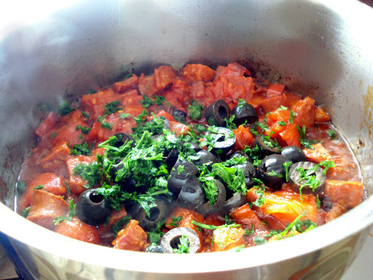 Cod with tomatoes, olives and chorizo by Laka kuharica: Stir in olives and parsley
