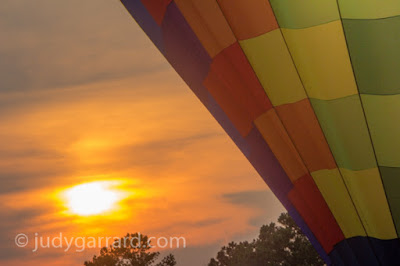 Sun setting behind a hot air balloon