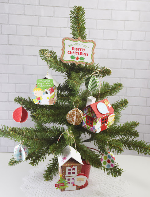i like placing different themed trees around my house and i knew i had to make a tree using these mini house ornaments and the darling christmas town - House Christmas Ornament