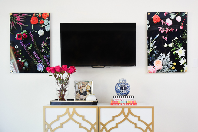 The Flora print from Jenny's Print Shop looks gorgeous flanking a TV in a master bedroom. Love this TV gallery wall idea.