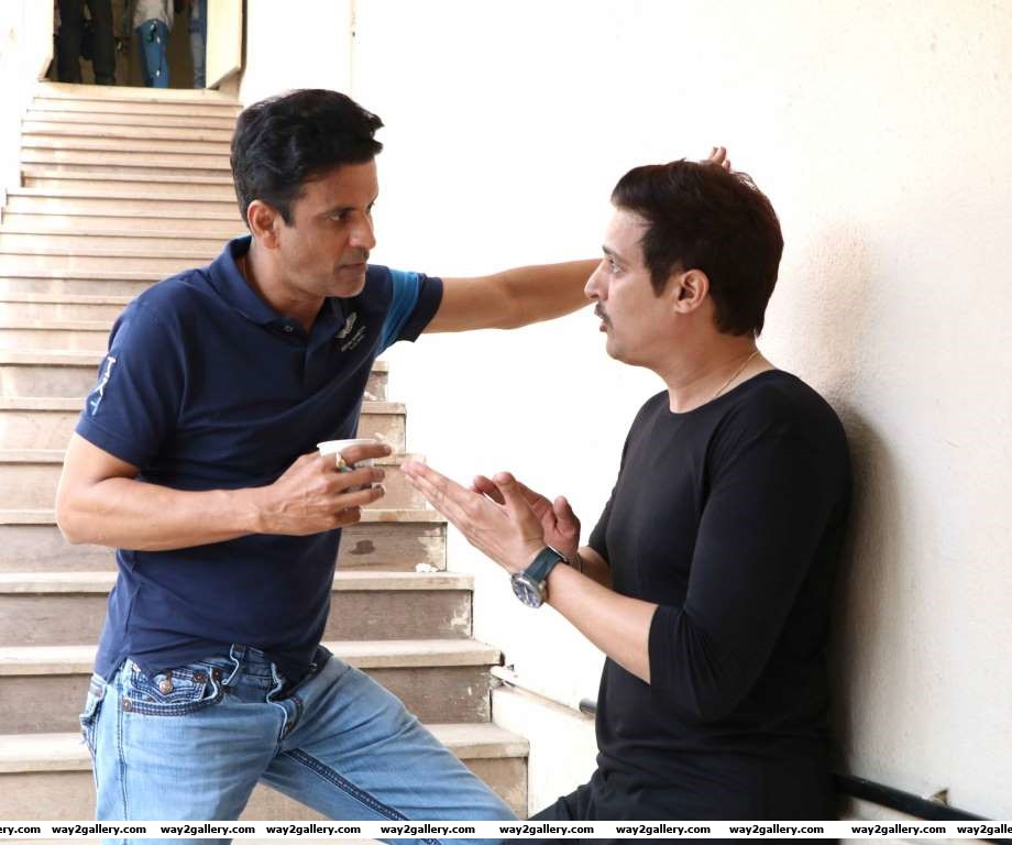 Manoj Bajpayee in conversation with Jimmy Shergill during a promotional event for their upcoming film Traffic
