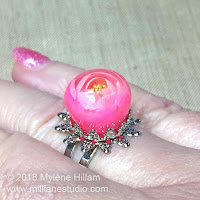 Candy ball resin ring using UV gel resin and alcohol ink.