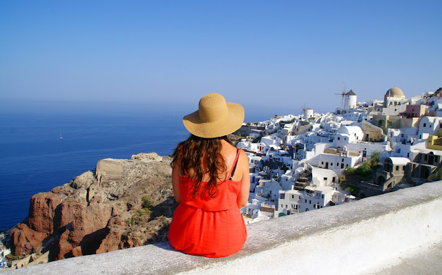 Girl overlooking Oia Santorini