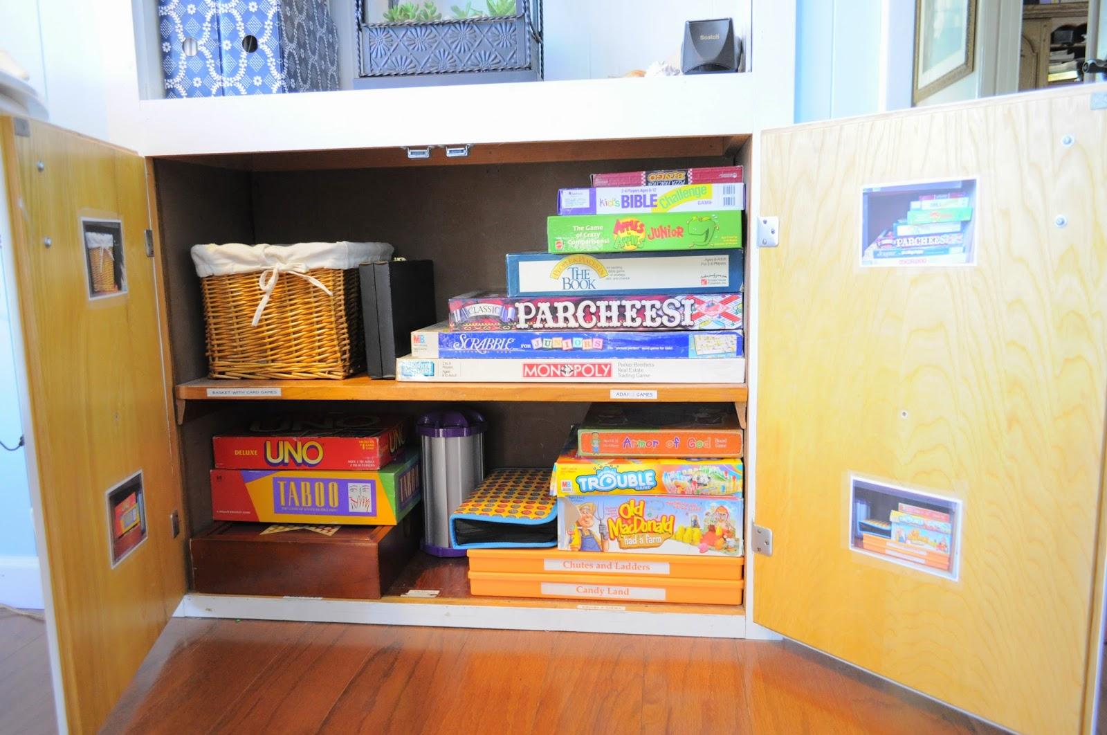 Organized Game cupboard in the family room :: OrganizingMadeFun.com