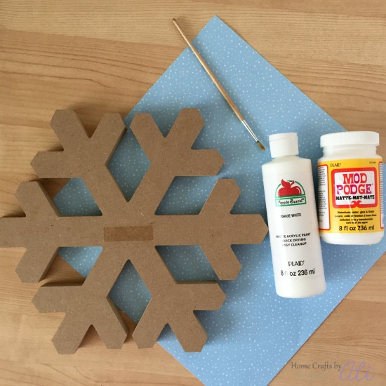 wood snowflake and crafting supplies