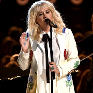 Watch Kesha pay tribute to Bob Dylan at the 2016 Billboard Music Awards now at JasonSantoro.om