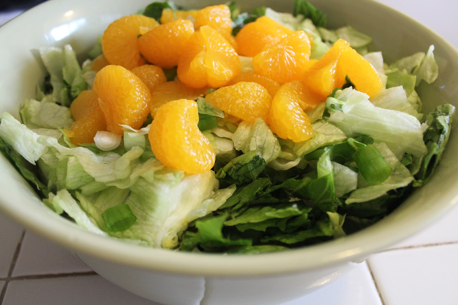 An easy recipe for Mandarin Orange and Spinach Pasta Salad loaded with goodness and topped with an easy 3 ingredient dressing!