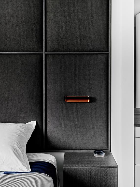 Bedroom, corduroy headboard | Hampton Penthouse. Interior design by Huntly, photo by Brooke Holm