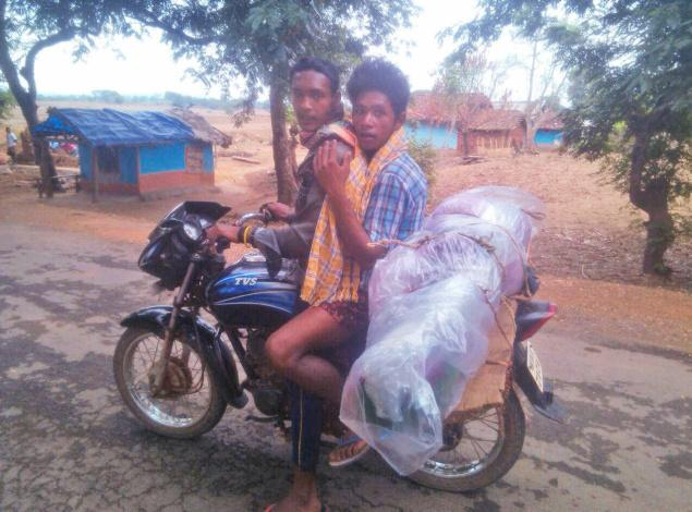 Two Odisha youth were recently photographed transporting a dead woman on their bike.   The local media said the two youth, possibly tribals, were too poor to hire any other vehicle to transport the remains of the woman.   They had tightly wrapped the woman in polyethylene sheets and hung her to the bike's carrier with the support of a cardboard.
