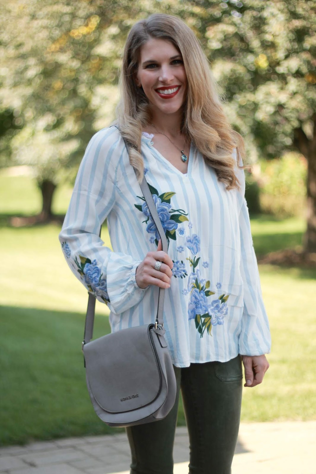 blue striped embroidered tunic, olive pants, grey peep toe booties, grey saddle bag,