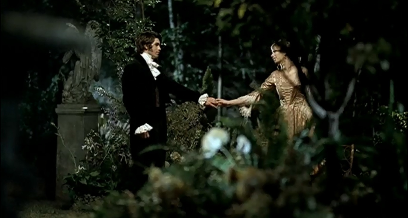 Romeo and Juliet meeting in the garden in music video for