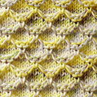 Diamond Honeycomb Slipped stitch pattern. Skills Required: Knit, Purl, Slip stitch and Knit stitch under loose strands