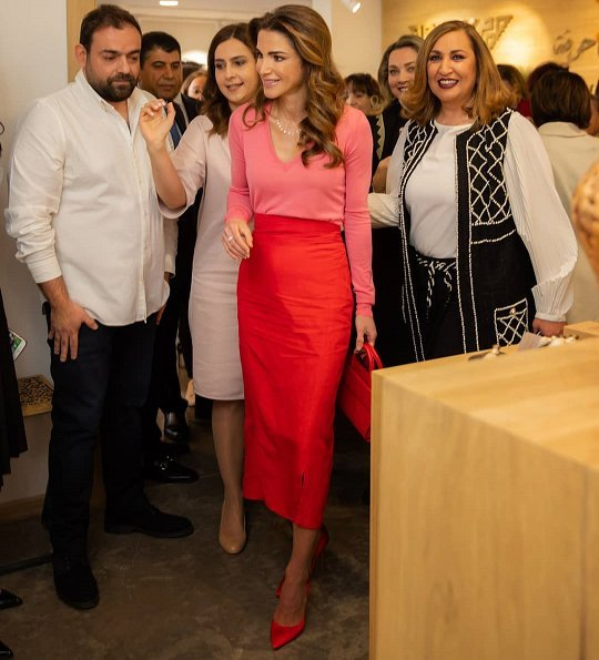 Queen Rania carried Givenchy horizon mini leather satchel bag. Queen Rania wore a red skirt and pink sweater by Givenchy