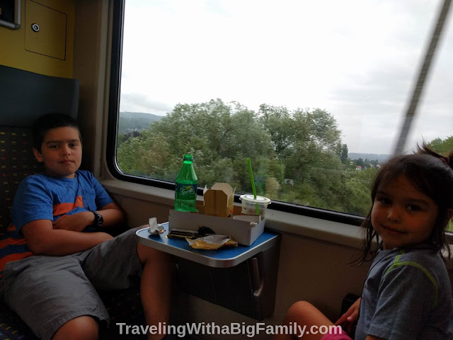 Traveling with a big family and eating while riding the train in Europe