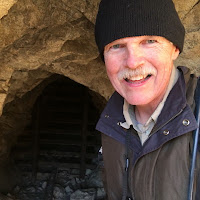 Dan Simpson in the mouth of a horizontal mine shaft, Desert Queen Mine, Joshua Tree National Park