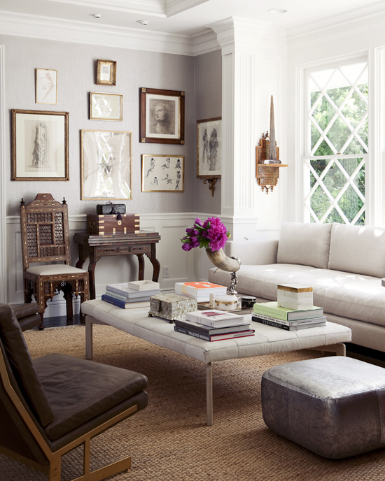 Contemporary white ottoman in an eclectic living room photographed by Michael Wells.