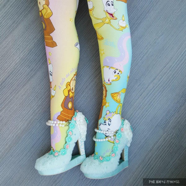 side legs wearing disney pastel tights and fluffy shoes