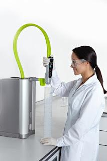 laboratory technician dispensing purified water
