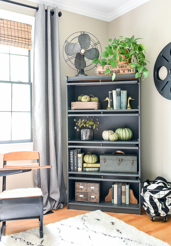 Bookcase decorated with fall decor
