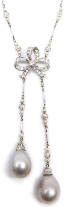 An antique diamond bow and pearl sautoir necklace.