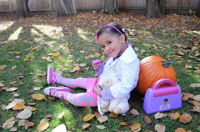Toddler in Doc McStuffins Costume with Lambie and A Doctor Bag