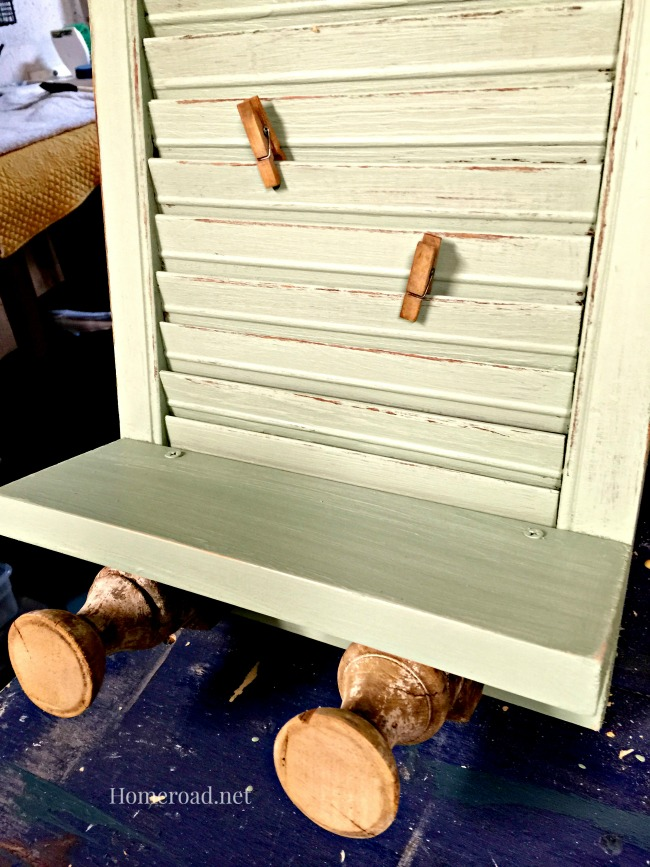 shutter with pegs and shelf