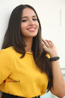 Actress Poojitha Stills in Yellow Short Dress at Darshakudu Movie Teaser Launch .COM 0163.JPG