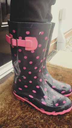 Blue and pink polka dot welly boots and splashing in puddles