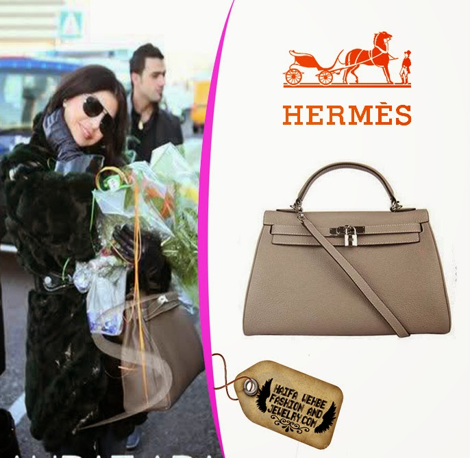 Haifa Wehbe completed her look with this Gray Kelly Bag with silver  hardware by Hermes. Haifa carried this bag with her Versace fur coat and  blue denim ... 09a5285e1248a