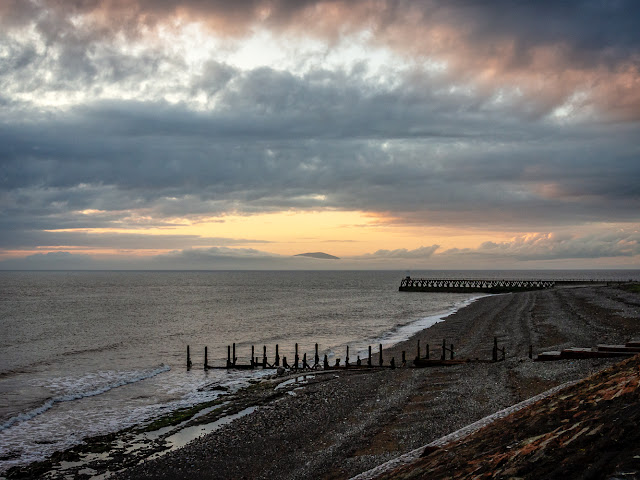 Photo of Maryport beach at sunset with one Scottish hill just visible in the distance