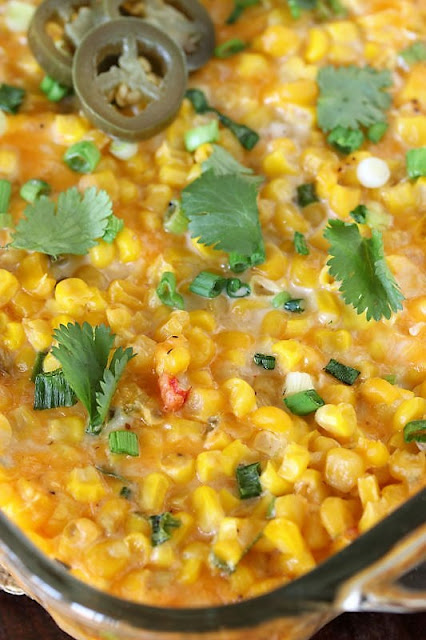Cheesy Fiesta Corn Casserole in Baking Dish Topped with Chopped Cilantro and Jalapenos Image