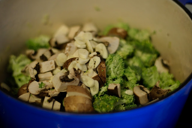 Broccoli, mushrooms, and garlic in the pot.