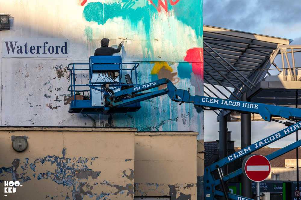 Street artist at work at the Irish Street Art Festival Waterford Walls
