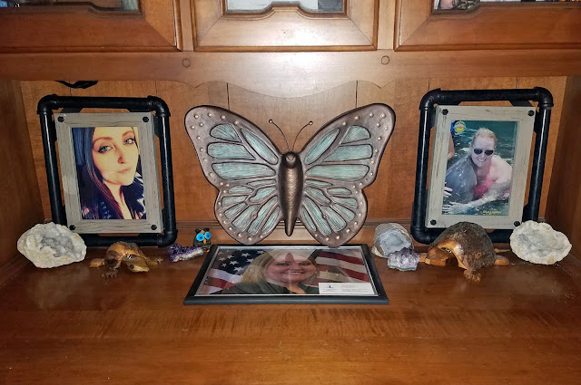 in memory, large butterfly urn