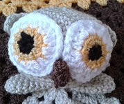 http://www.ravelry.com/patterns/library/hooty-the-owl-lovey---comforter