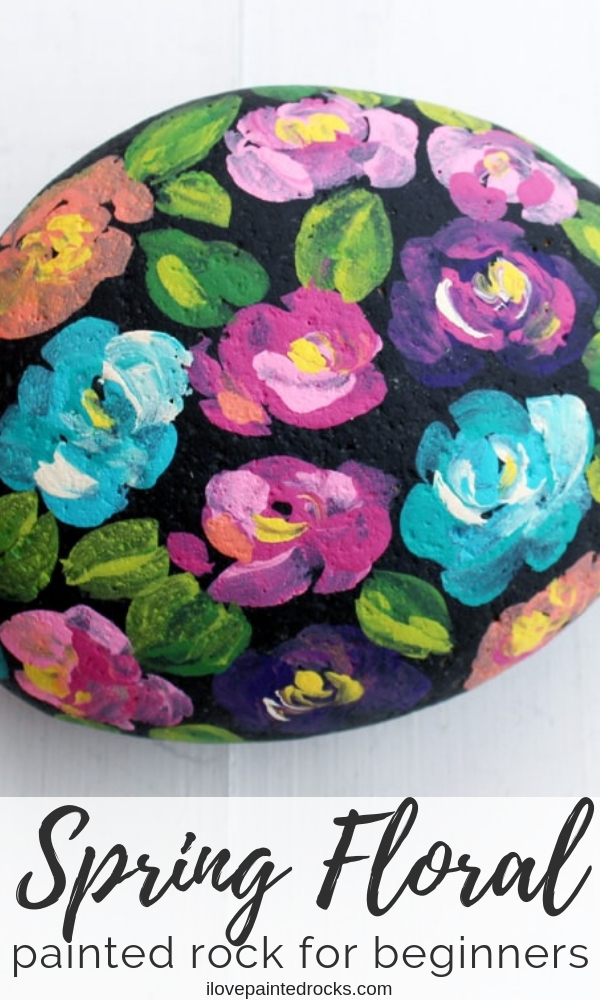 How to paint flowers on painted rocks. This easy rock painting technique will have you painting many pretty colors of roses with a simple trick! #ilovepaintedrocks #rockpainting #flowerpaintedrocks #flowerrocks #stonepainting #paintedstone