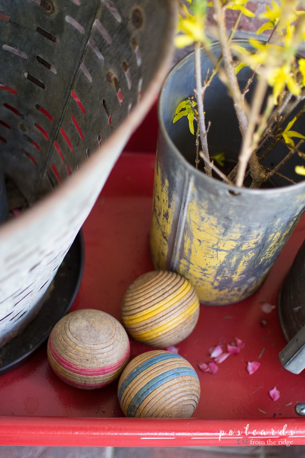 vintage wooden croquet balls as front porch decor