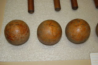 Three round wooden croquet balls - some traces of paint are still visible