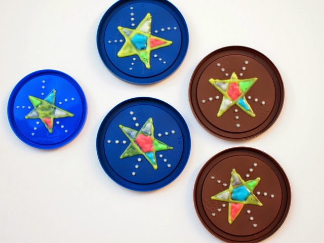 Paint lids with glow in the dark paint stars