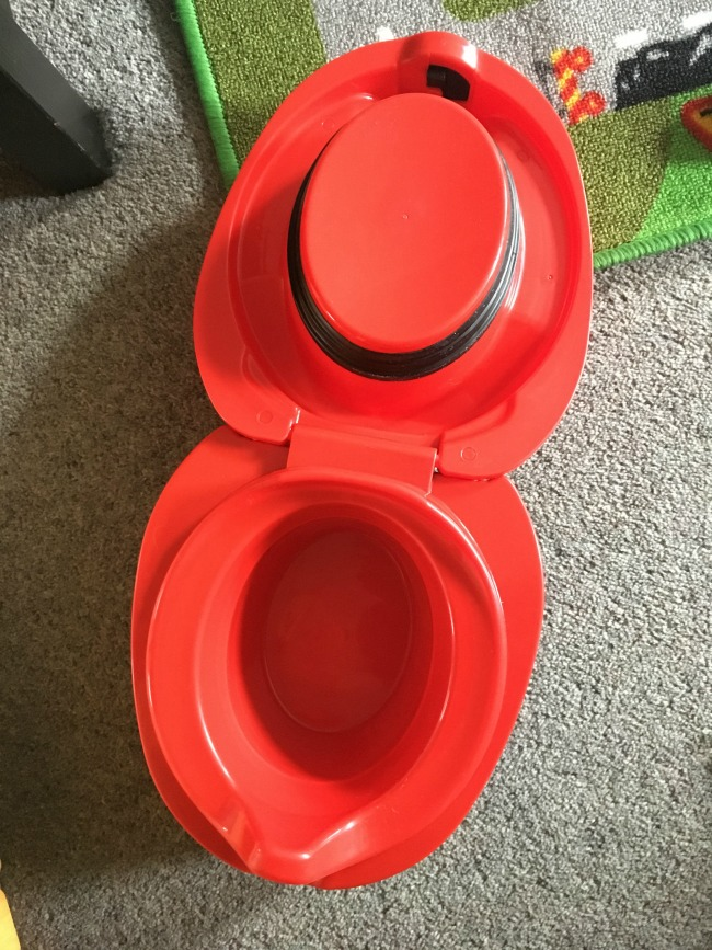 My-Carry-Potty-from-Cheeky-Rascals-Review-ladybird-design-open-showing-seal