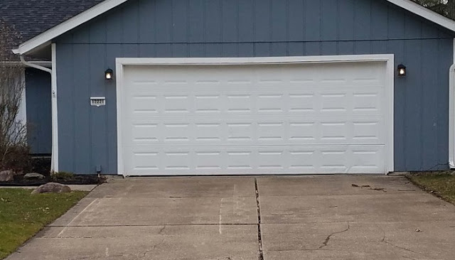 dented aluminum garage door repair