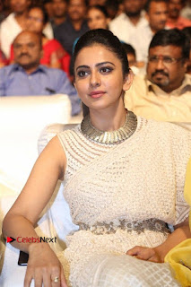 Actress Rakul Preet Singh Stills in White Dress at Winner Pre Release Function  0027.jpg